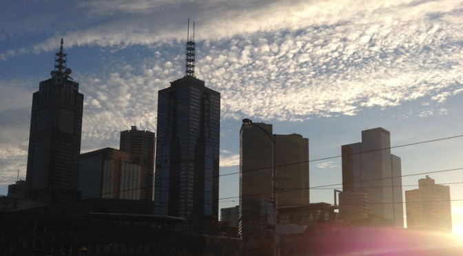 The Melbourne Skyline with a mixture of cloud pattern, blue sky and some lens flare.